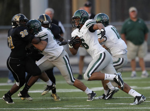 Jordan Evans (6) runs the ball during a high school football game between Midwest City and Norman North in Midwest City, Friday, Sept. 21, 2012.  Photo by Garett Fisbeck, The Oklahoman