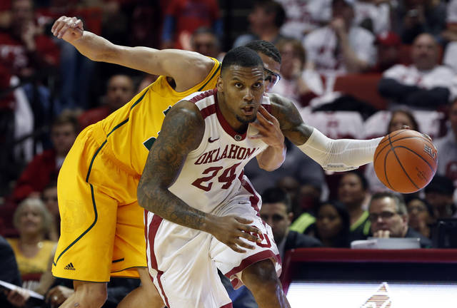 Baylor Bear's Isaiah Austin reaches around Oklahoma Sooner's Romero Osby (24) in the second half as the University of Oklahoma Sooners (OU) men defeat the Baylor University Bears (BU) 90-76 in NCAA, college basketball at The Lloyd Noble Center on Saturday, Feb. 23, 2013  in Norman, Okla. Photo by Steve Sisney, The Oklahoman