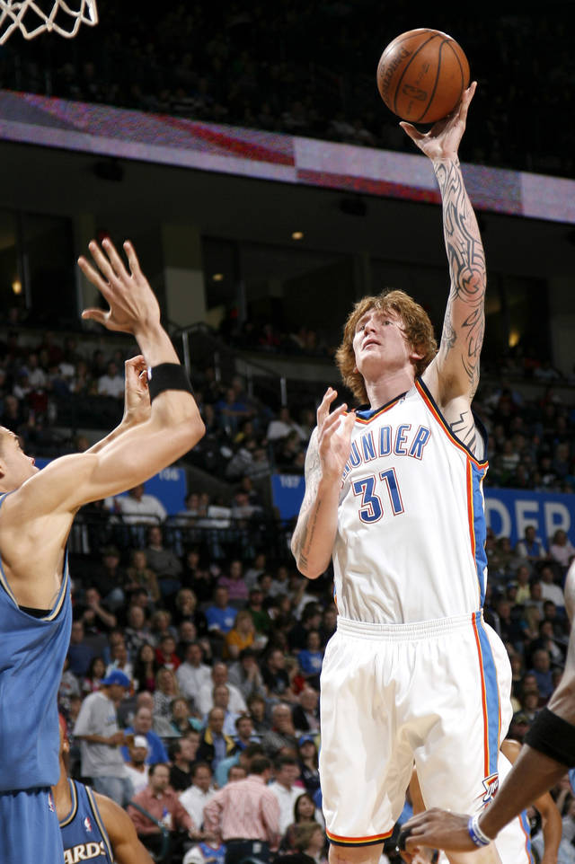Oklahoma City's Robert Swift shoots the ball during the NBA basketball game between the Oklahoma City Thunder and the Washington Wizards at the Ford Center in Oklahoma City, Wed., March 4, 2009. PHOTO BY BRYAN TERRY, THE OKLAHOMAN