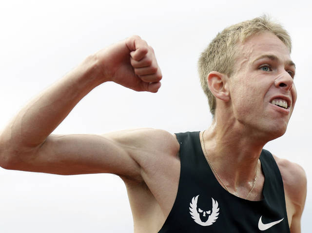Galen Rupp celebrates after finishing first in the men's 5,000 meter finals at the U.S. Olympic Track and Field Trials Thursday, June 28, 2012, in Eugene, Ore. (AP Photo/Marcio Jose Sanchez)
