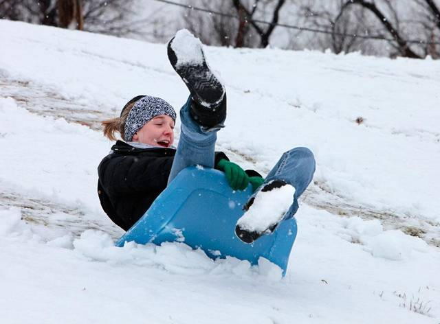 Ashton Carpenter sleds down a hill near NW 36th and Lake Hefner Parkway, Tuesday, February 12, 2013.   Photo By David McDaniel/The Oklahoman