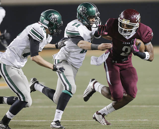 Jenks' Jordan Smallwood (2) runs past Norman North's Carter Klein (10) and D.J. Gasso (11) during the Class 6A Oklahoma state championship football game between Norman North High School and Jenks High School at Boone Pickens Stadium on Friday, Nov. 30, 2012, in Stillwater, Okla.   Photo by Chris Landsberger, The Oklahoman