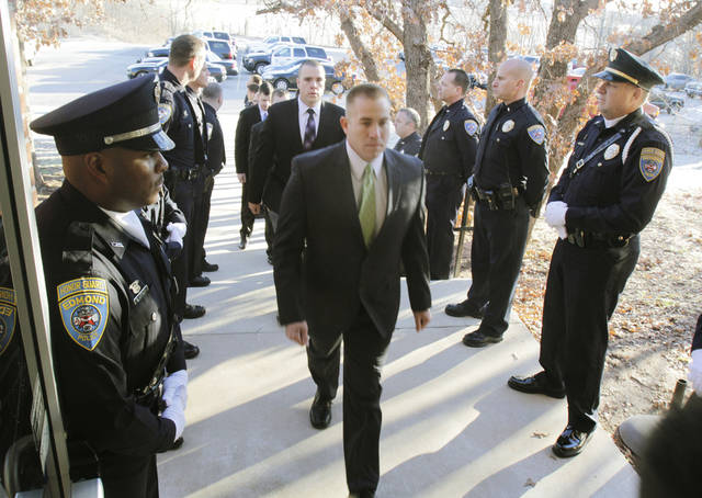 Cadets walk past the Edmond Police Honor Guard, as the Edmond Police Department's second police academy has its opening ceremonies at the Edmond Police Department Firing Range in Edmond, OK, Monday, Nov. 28, 2011. By Paul Hellstern, The Oklahoman