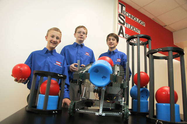 Students at Summit Middle School in Edmond are raising money to go to a national technology competition. Pictured are robotics team members, from left, Max Huss, 14, Don Wright, 14, and Jackson Baker, 14. Photo by Doug Hoke, The Oklahoman