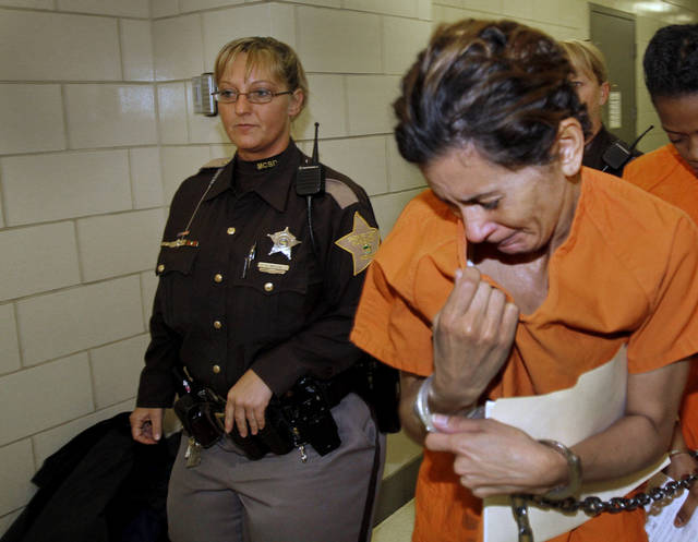 "A teary-eyed Monserrate Shirley returns to jail after entering a not guilty plea in the arraignment for the fatal Richmond Hill blast, at the City/County building, Monday, Dec. 24, 2012. Monserrate Shirley, 47, her boyfriend, Mark Leonard, 43, and his half brother Robert ""Bob"" Leonard Jr., 54, are facing murder and several other felony charges in what authorities have called a senseless crime. (AP Photo/Indianapolis Star, Kelly Wilkinson)"