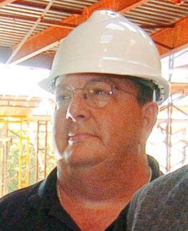 Bill Dwight Coyle, a former business manager of St. John the Baptist Catholic Church, is shown in 2005 when the Edmond church's sanctuary was being renovated. Coyle was charged Monday with eight felony counts. Photo by Paul Hellstern, The Oklahoman Archives <strong></strong>