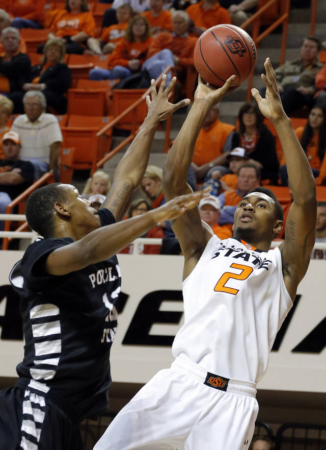 Oklahoma State's Le'Bryan Nash (2) shoots over Portland State's Michael Harvey (13)during the college basketball game between Oklahoma State University and Portland State, Sunday,Nov. 25, 2012. Photo by Sarah Phipps, The Oklahoman