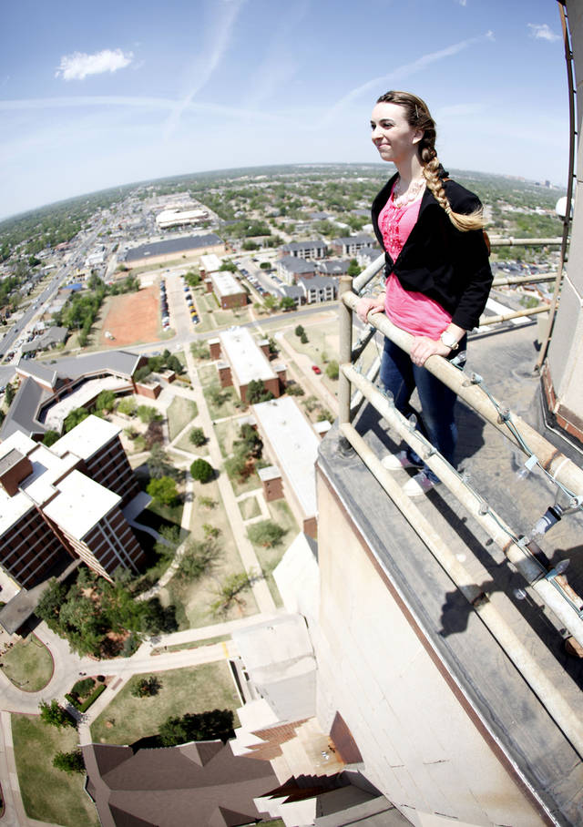 Oklahoman reporter Amanda Alfanos takes in the view from the top of the 287 ft. tall Gold Star Memorial building on the campus of Oklahoma City University in Oklahoma City, OK, Thursday, April 14, 2011. By Paul Hellstern, The Oklahoman