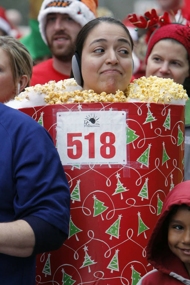 Susana Rubio dresses as a popcorn tin during the SandRidge Santa Run in downtown Oklahoma City, OK, Saturday, December 8, 2012,  By Paul Hellstern, The Oklahoman