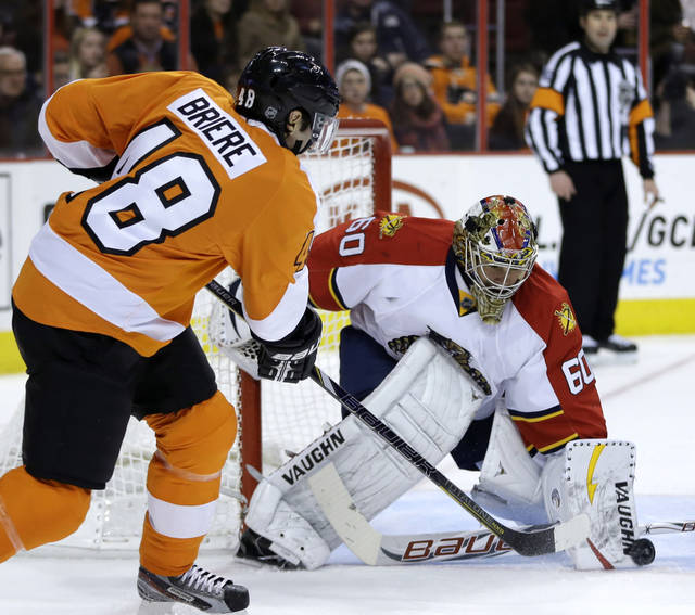 Florida Panthers' Jose Theodore, right, blocks a shot by Philadelphia Flyers' Danny Briere during the second period of an NHL hockey game, Thursday, Feb. 7, 2013, in Philadelphia. (AP Photo/Matt Slocum)