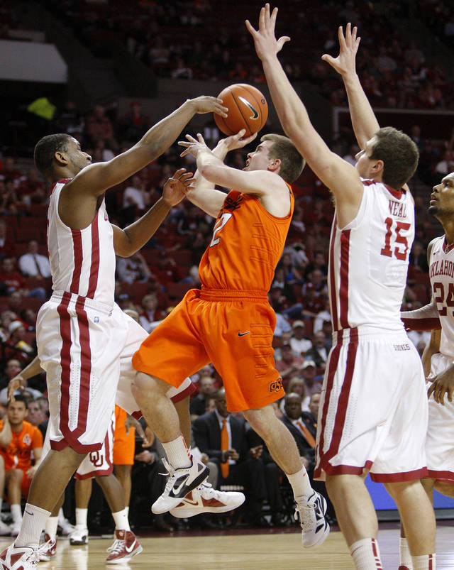 Oklahoma State's Keiton Page (12) tries to go between Oklahoma's Steven Pledger (2) and Tyler Neal (15) during the Bedlam men's college basketball game between the University of Oklahoma Sooners and the Oklahoma State Cowboys in Norman, Okla., Wednesday, Feb. 22, 2012. Oklahoma won 77-64.  Photo by Bryan Terry, The Oklahoman