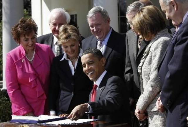 President Barack  Obama is surrounded by lawmakers as he  signs the HIRE Act  jobs bill in the Rose Garden of the White House in Washington, Thursday, March 18, 2010. From left are Rep. Deborah Halvorson, D-Ill., Rep. Sander Levin, D-Mich., Sen. Barbara Boxer, D-Calif., third left, Sen. Richard Durbin, D-Ill., fourth left, Senate Majority Leader Harry Reid, D-Nev., fifth right, House Speaker Nancy Pelosi, D-Calif., third right, Sen. Chuck Schumer, D-N.Y. (AP Photo/Charles Dharapak)