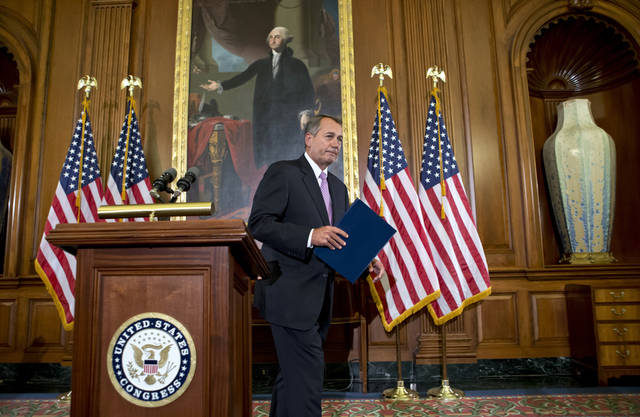 "Speaker of the House John Boehner, R-Ohio, finishes a prepared statement to reporters about the elections and the unfinished business of Congress, at the Capitol in Washington, Wednesday, Nov. 7, 2012. The first post-election test of wills could start next week when Congress returns from its election recess to deal with unfinished business � including a looming ""fiscal cliff"" of $400 billion in higher taxes and $100 billion in automatic cuts in military and domestic spending to take effect in January if Congress doesn't head them off. Economists warn that the combination could plunge the nation back into a recession. (AP Photo/J. Scott Applewhite)"
