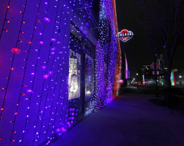 A view of Christmas lights on the Schlegel Bicycles building along Automobile Alley during a light rain near 8th and Broadway in downtown Oklahoma City, Monday, Dec. 12, 2011. Photo by Nate Billings, The Oklahoman