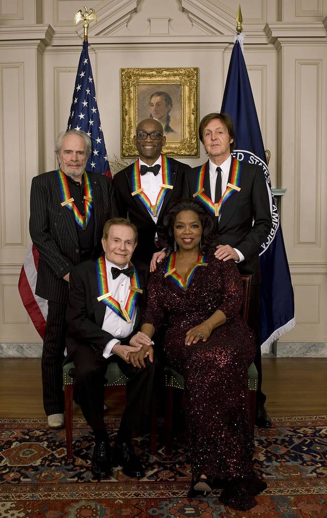 """The 33rd Annual Kennedy Center Honors,"" 8 p.m. Tuesday on CBS, features, left to right, singer and songwriter Merle Haggard; composer and lyricist Jerry Herman; dancer, choreographer and director Bill T. Harris; producer and television host Oprah Winfrey; and songwriter and musician Paul McCartney.CBS Photo"