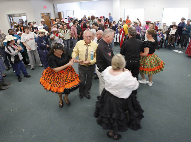 Members of the Central District Square Dance Association dance at a Dale Rogers Center party honoring Dale Evans Rogers' 100th birthday.   Photo By David McDaniel, The Oklahoman <strong>David McDaniel - The Oklahoman</strong>