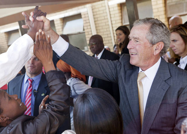 In this photo provided by the George W. Bush Presidential Center, former President George W. Bush and his wife, Laura Bush stop to talk with people who have lined the hallways of the Princess Marina Hospital in Gaborone, Botswana, on Thursday, July 5, 2012. The former president and his wife visited Africa for a week to promote a partnership between the George W. Bush Institute, the U.S. President's Emergency Plan for AIDS Relief, UNAIDS and Susan G. Komen for the Cure, that aims to fight cervical and breast cancer in sub-Saharan Africa. (AP Photo/George W. Bush Presidential Center, Shealah Craighead)