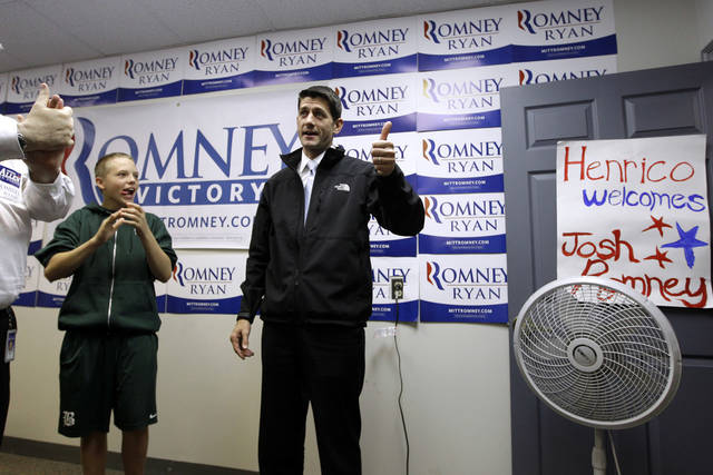 Republican vice presidential candidate, Rep. Paul Ryan, R-Wis. speaks to volunteers at a GOP field office, Tuesday, Nov. 6, 2012, in Henrico County, Va. (AP Photo/Mary Altaffer)