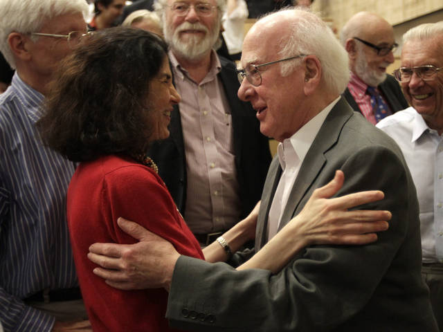 "British physicist Peter Higgs, right, congratulates Fabiola Gianotti, ATLAS experiment spokesperson, after her results presentation during a scientific seminar to deliver the latest update in the search for the Higgs boson at the European Organization for Nuclear Research (CERN) in Meyrin near Geneva, Switzerland, Wednesday, July 4, 2012. The head of the world's biggest atom smasher is claiming discovery of a new particle that he says is consistent with the long-sought Higgs boson known popularly as the ""God particle"" which is believed to give all matter in the universe size and shape. (AP Photo/Denis Balibouse, Pool)"
