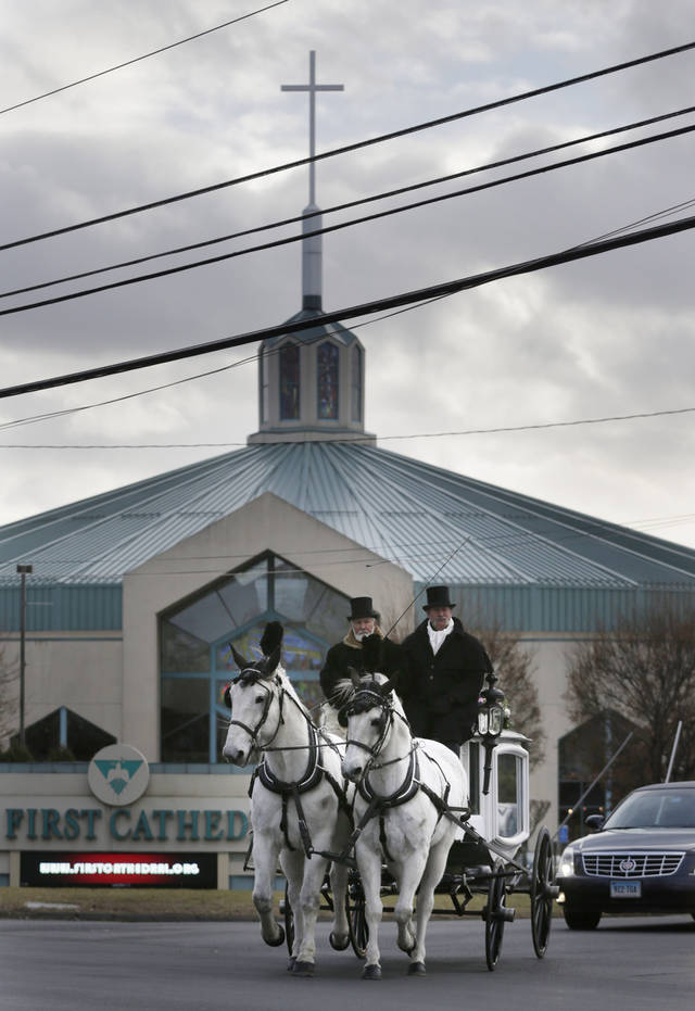 A horse drawn carriage carrying the body of Anna Grace Marquez-Greene leaves the church after her funeral in Bloomfield, Conn., Saturday, Dec. 22, 2012.  Marquez-Greene, 6,  was killed when gunman Adam Lanza opened fire at Sandy Hook Elementary School last week, killing 26 people, including 20 children, before killing himself. (AP Photo/Seth Wenig) ORG XMIT: CTSW110