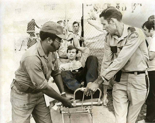 PENAL INSTITUTION / OKLAHOMA STATE PENITENTIARY / McALESTER PRISON RIOT 1973: One of the injured is removed from prison grounds on a stretcher. Staff Photo by Don Tullous. Original photo taken 07/28/1973, published 07/29/1973 in The Daily Oklahoman E. ORG XMIT: OKC1307251029023396