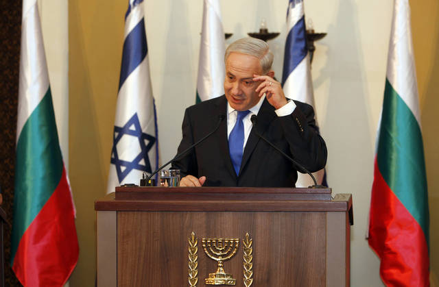 Israeli Prime Minister Benjamin Netanyahu speaks during a joint press conference with his Bulgarian counterpart Boyko Borissov, not seen,in Jerusalem, Tuesday, Sept. 11, 2012. Netanyahu expressed on Tuesday his dissatisfaction with Washington's refusal to spell out what would provoke a U.S.-led military strike against Iranian nuclear facilities.(AP Photo/Gali Tibbon, Pool)