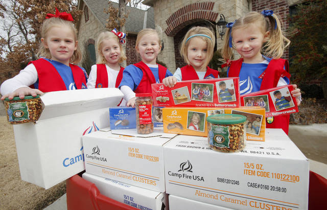 Kaelyn Eddy, 5, Julianne Reed, 5, Ella Mills, 4, Cori Morrison, 4, and Kynzee Champ, 4, with Camp Fire candy and nuts for sale in Edmond Friday, Jan. 13, 2012. Photo by Paul B. Southerland, The Oklahoman