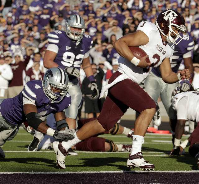 FILE - In this file photo made Nov. 12, 2011, Texas A&M quarterback Jameill Showers (3) gets past Kansas State linebacker Arthur Brown (4) to score a touchdown during the second quarter of an NCAA college football game in Manhattan, Kan. Showers will forever go down as the guy whom Johnny Manziel beat out in the preseason before going on to become the first freshman to win the Heisman trophy. And that was after Showers was the backup to eventual first-round NFL draft pick Ryan Tannehill. He'll finally get a chance with the Miners to show what he's got, and it will likely make Sean Kugler's first season as UTEP's coach much better.  (AP Photo/Charlie Riedel, file)