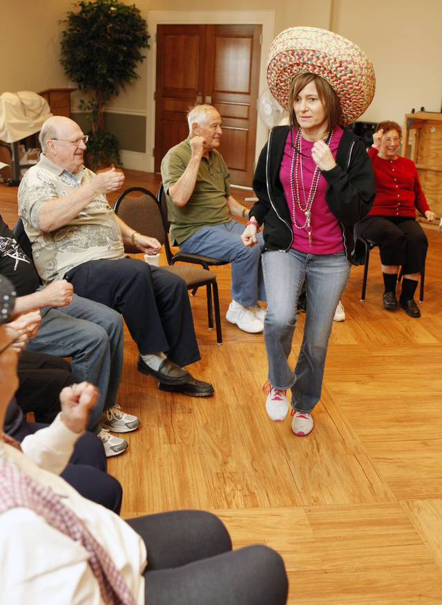 Instructor Elaine Fellers gets class participation going as the Edmond Senior Center holds a laughing yoga class at the Multi-Activity Center in Edmond, OK, Friday, Feb. 17, 2012. By Paul Hellstern, The Oklahoman