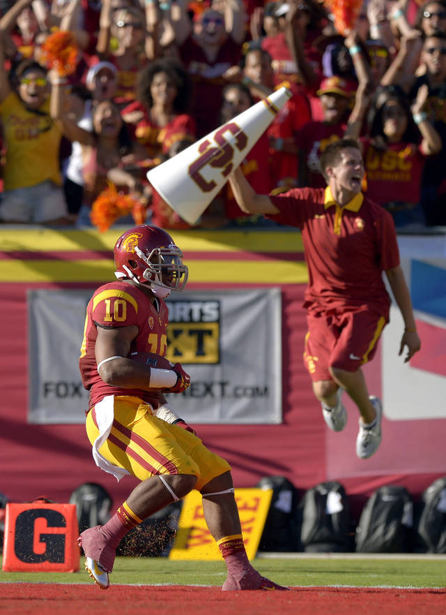 Southern California linebacker Hayes Pullard scores a touchdown on an interception during the first half of their NCAA college football game against Hawaii, Saturday, Sept. 1, 2012, in Los Angeles. (AP Photo/Mark J. Terrill)