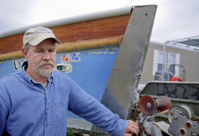 CORRECTS SPELLING OF NAME TO SWIFT Glen Swift stands by one of his boats in Port Sulphur, La., Saturday, March 3, 2012. Swift, a fisherman in Buras, said he worked cleanup boats and got sick one day cleaning up a big patch of oil. He said he wasn't sure if he would file a medical claim. (AP Photo/Matthew Hinton)