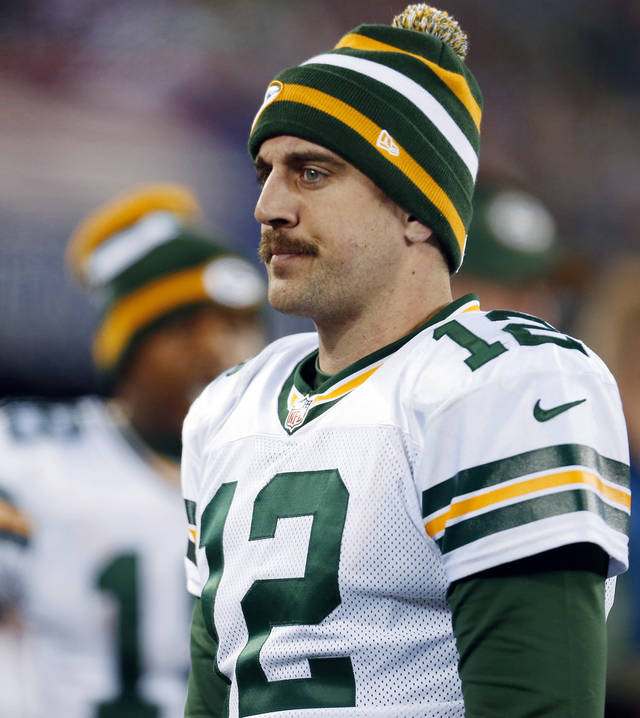 Green Bay Packers' Aaron Rodgers (12) reacts during the second half of an NFL football game against the New York Giants on Sunday, Nov. 25, 2012, in East Rutherford, N.J. (AP Photo/Julio Cortez)
