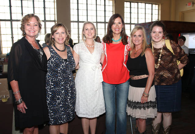 Tricia Wallis, Jennifer Monies, Carolyn Pickthorn, Carrie Mayes, Tammy Werner and Kristin Ellis support the Baron's Ball.