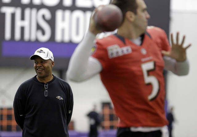 Baltimore Ravens offensive coordinator Jim Caldwell, back left, looks on as quarterback Joe Flacco warms up during NFL football practice at the team's training facility in Owings Mills, Md., Friday, Jan. 25, 2013. The Ravens are scheduled to face the San Francisco 49ers in Super Bowl XLVII in New Orleans on Sunday, Feb. 3. (AP Photo/Patrick Semansky)