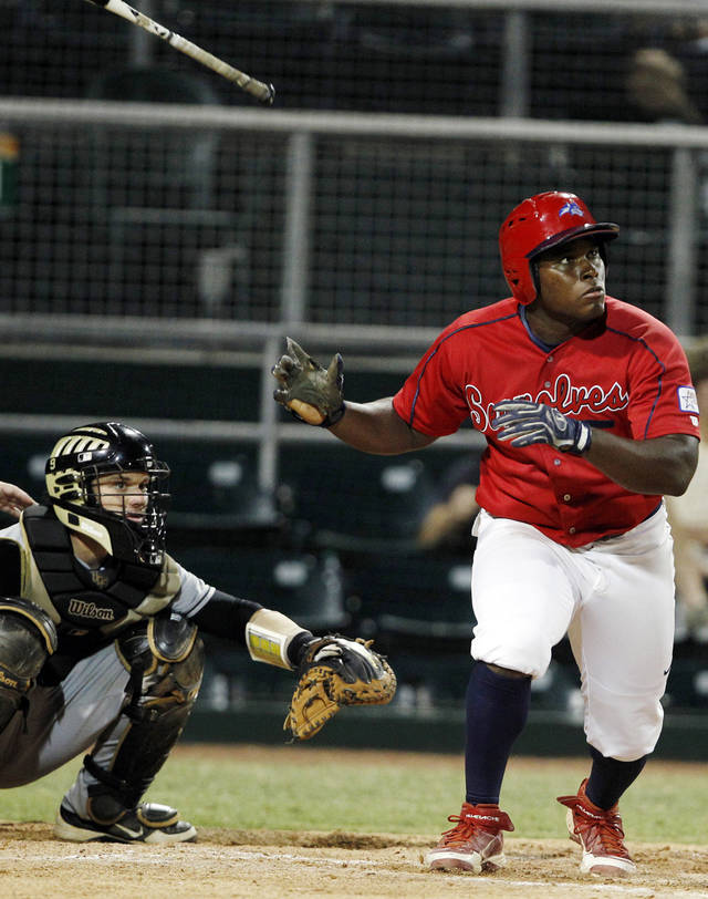 Stony Brook's William Carmona, right, tosses his bat after hitting a solo home run as Central Florida catcher Ryan Breen, left, watches in the seventh inning during an NCAA college baseball tournament regional championship game, Monday, June 4, 2012, in Coral Gables, Fla. (AP Photo/Lynne Sladky)