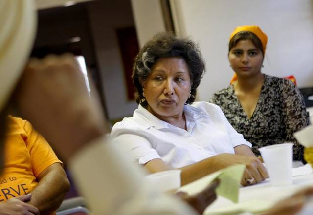 Umi Kaur Chahal participates in a meetng of metro Sikhs and Guneet Kaur Saluja, far right, sits nearby at the Sikh Gurdwara of Oklahoma, 4525 NW 16. <strong>BRYAN TERRY - BRYAN TERRY</strong>