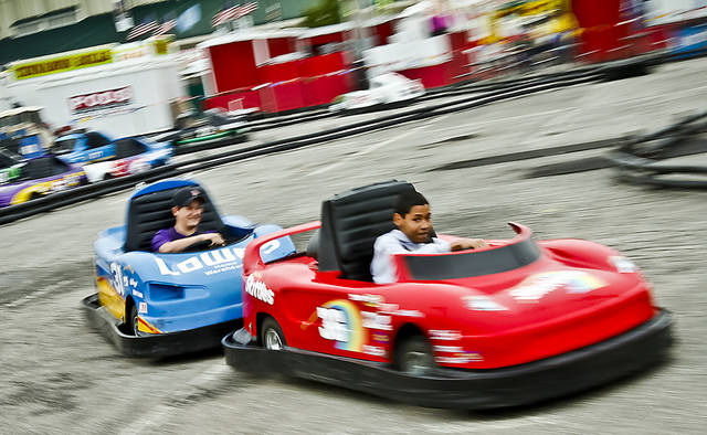 Fair visitors race go carts at the Oklahoma State Fair at State Fair Park on Friday, Sept. 14, 2012, in Oklahoma City, Oklahoma.  Photo by Chris Landsberger, The Oklahoman