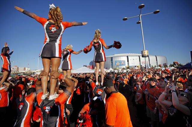 The OSU cheer team entertains the crowd before the Fiesta Bowl between the Oklahoma State University Cowboys (OSU) and the Stanford Cardinal at the University of Phoenix Stadium in Glendale, Ariz., Monday, Jan. 2, 2012. Photo by Bryan Terry, The Oklahoman