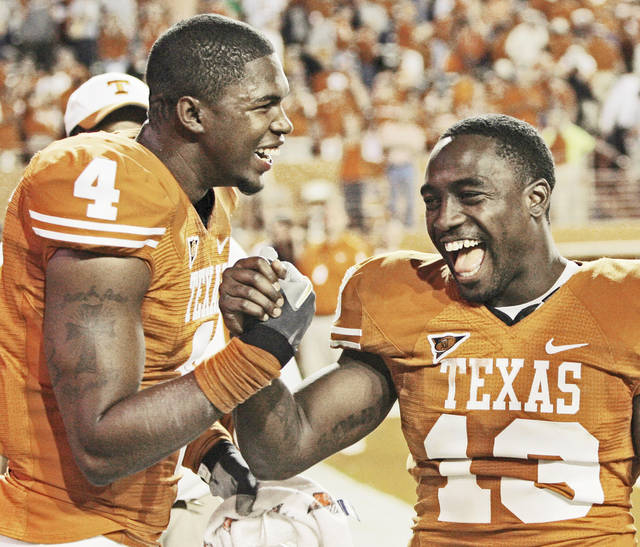 Texas wide receiver Dan Buckner, left, had five catches for 62 yards in the Longhorns' opener.AP photo