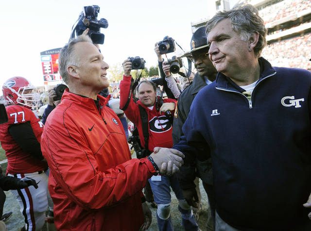 Georgia head coach Mark Richt, left, and Georgia Tech head coach Paul Johnson meet on the field after an NCAA college football game, Saturday, Nov. 24, 2012, in Athens, Ga. Georgia won 42-10. (AP Photo/John Amis)