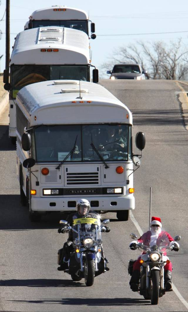 Solders are lead by Santa on a motorcycle as they travel around town for Soldiers Day Out, Friday, December 21, 2012. Edmond/North OKC Blue Star Mothers will be taking the soldiers who can't go home for Christmas around the metro for a day of fun. Photo By David McDaniel/The Oklahoman