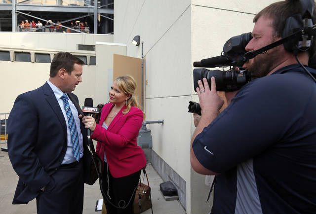 OU head coach Bob Stoops gives an interview to ESPN&#039;s Holly Rowe after arriving at the stadium before the Red River Rivalry college football game between the University of Oklahoma (OU) and the University of Texas (UT) at the Cotton Bowl in Dallas, Saturday, Oct. 13, 2012. Photo by Nate Billings, The Oklahoman