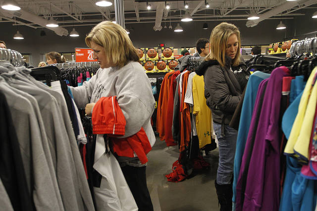 Amy Jones, of El Reno, and Sabrina Brown, of Mcloud, shop at Under Armour during Black Friday at The Outlet Shoppes at Oklahoma City, Thursday, Nov. 24, 2011.  Photo by Garett Fisbeck, For The Oklahoman