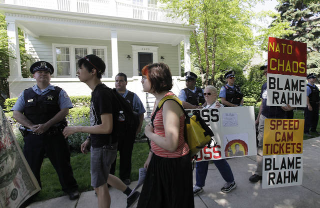 Protesters march in front of Chicago Mayor Rahm Emanuel's house as part of a NATO summit demonstration in Chicago, Saturday, May 19, 2012. (AP Photo/ Nam Y. Huh)