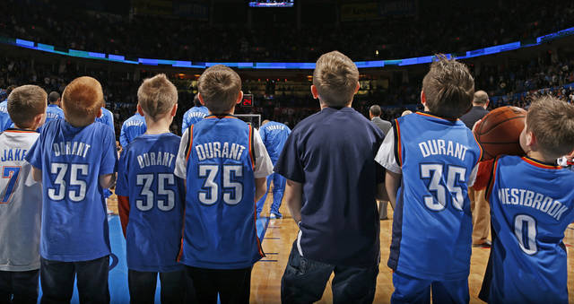 Children line the court before an NBA basketball game between the Oklahoma City Thunder and the Golden State Warriors at Chesapeake Energy Arena in Oklahoma City, Wednesday, Feb. 6, 2013. Photo by Bryan Terry, The Oklahoman