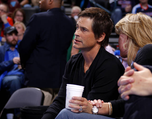 Rob Lowe watches during an NBA basketball game between the Oklahoma City Thunder and the Los Angeles Lakers at Chesapeake Energy Arena in Oklahoma City, Thursday, Feb. 23, 2012. Photo by Bryan Terry, The Oklahoman