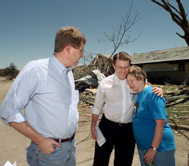 Congressman Frank Lucas looks on as  Rep Kevin Calvey gives Robin Collins a tornado damage victim a hug in Del City. Goes with Amy Green story.