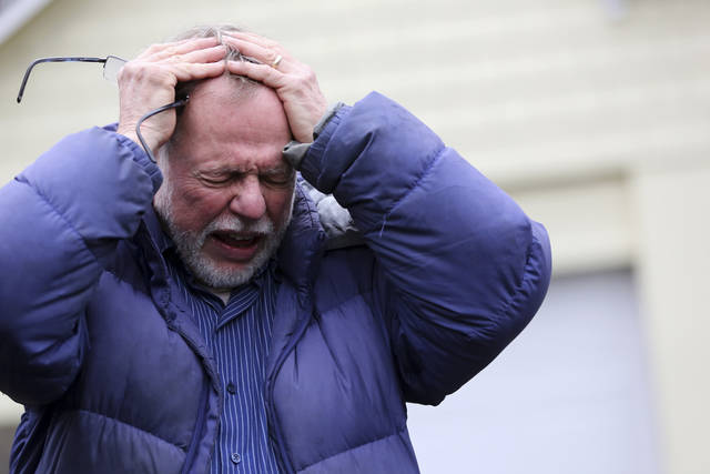 Gene Rosen becomes emotional as he describes, in an interview with The Associated Press, Monday, Dec. 17, 2012, that after Friday's shooting at Sandy Hook Elementary School, he took in six students who were sitting at the end of his driveway who had just run from the school to escape the deadly massacre. Rosen ran upstairs and grabbed an armful of stuffed animals he kept there. He gave those to the children, along with some fruit juice and sat with them as two of the students described seeing their teacher being shot. (AP Photo/Mary Altaffer) ORG XMIT: CTMA112