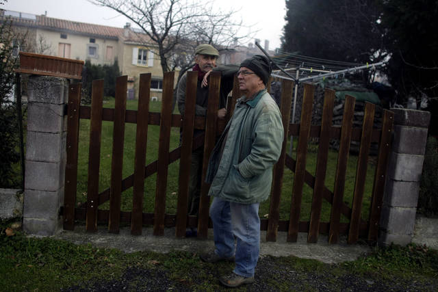 Two men converse in the town of Bugarach, France, Thursday, Dec. 20, 2012. The clock is ticking down to Dec. 21, the supposed end of the Mayan calendar, and from China to California to Mexico, thousands are getting ready for what they think is going to be a fateful day. The sleepy town of Bugarach, nestled in the French Pyrenees mountains, is bracing for the arrival of hundreds of New Age enthusiasts and UFO believers that want to witness the end of the Mayan Long Count calendar. (AP Photo/Marko Drobnjakovic)