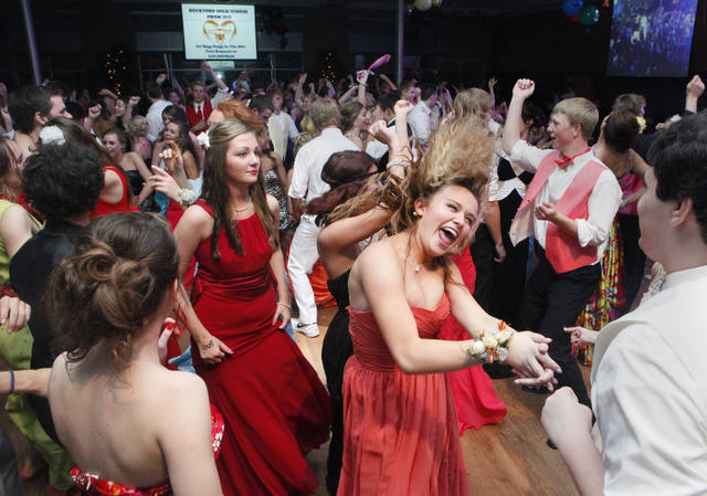In this Saturday, May 12, 2012 photo, Rockford High School students dance at The Pinnacle Center during their prom in Hudsonville, Mich. Prom spending is expected to rise in 2013 to an average $1,139. That's among families who are planning to spend some money to attend the annual affair, according to a survey of 1,025 parents of prom age teens by payment processor Visa Inc. and research company Gfk. Not included in the average were 12 percent who said they wouldn't spend anything on the prom. A majority of parents with teenagers surveyed were still unsure how much they'd spend.  (AP Photo/The Grand Rapids Press, Emily Zoladz)